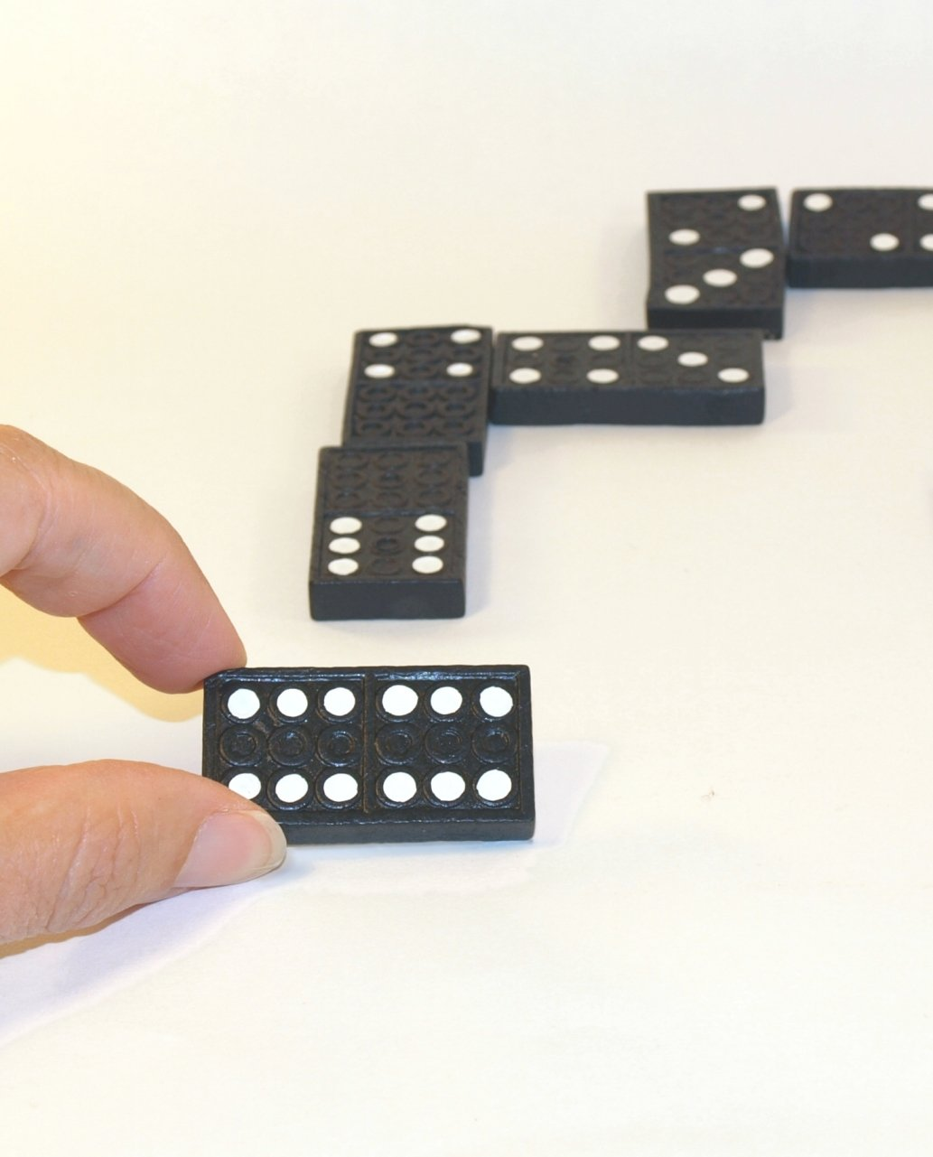 Why Motherhood is Like Playing Dominoes