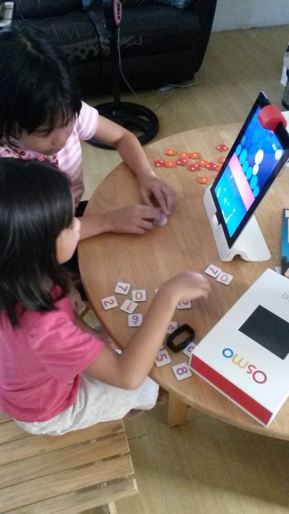 We don't mind using a little technology every once in a while. Raine teaches Breeze how to multiply with the Osmo app.